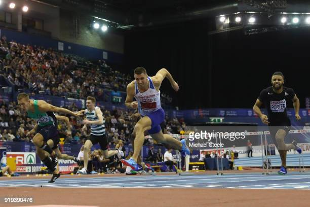Andrew Pozzi of StratfordUponAvon dips for the line to win the final of the 60m hurdles during day one of the SPAR British Athletics Indoor...