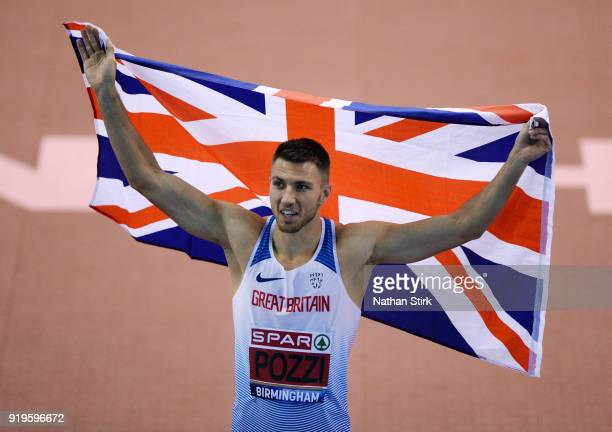 Andrew Pozzi of StratfordUponAvon raises the Great Britain flag after he wins his 60m hurdles heat during during the SPAR British Athletics Indoor...