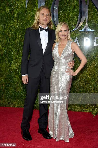 Andrew Pruett and host Kristin Chenoweth attend the 2015 Tony Awards at Radio City Music Hall on June 7 2015 in New York City