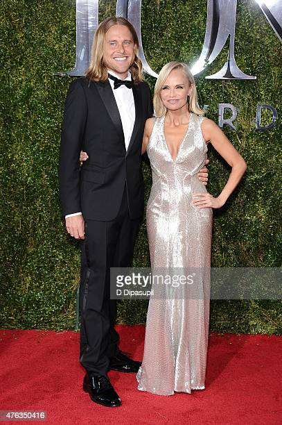 Andrew Pruett and Kristin Chenoweth attend the American Theatre Wing's 69th Annual Tony Awards at Radio City Music Hall on June 7 2015 in New York...