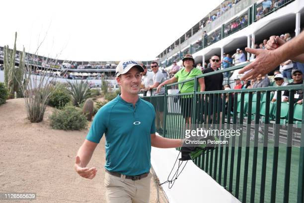 Andrew Putnam acknowledges a fan on his way to the 16th green during the first round of the Waste Management Phoenix Open at TPC Scottsdale on...