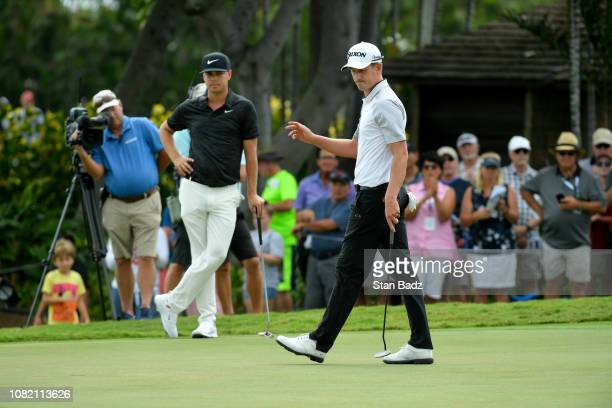 Andrew Putnam acknowledges the gallery on the third hole during the final round of the Sony Open in Hawaii at Waialae Country Club on January 13 2019...