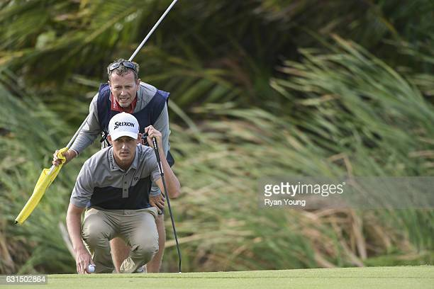 Andrew Putnam and his caddy line up a putt on the 18th hole during the final round of The Bahamas Great Exuma Classic at Sandals Emerald Bay Course...