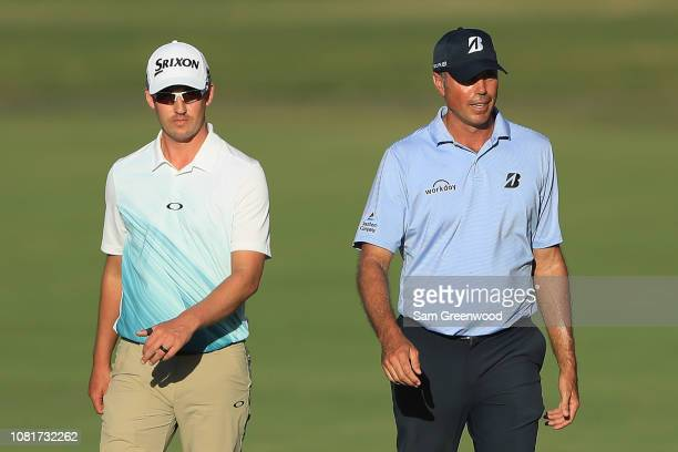 Andrew Putnam and Matt Kuchar of the United States walk on the 18th hole during the third round of the Sony Open In Hawaii at Waialae Country Club on...