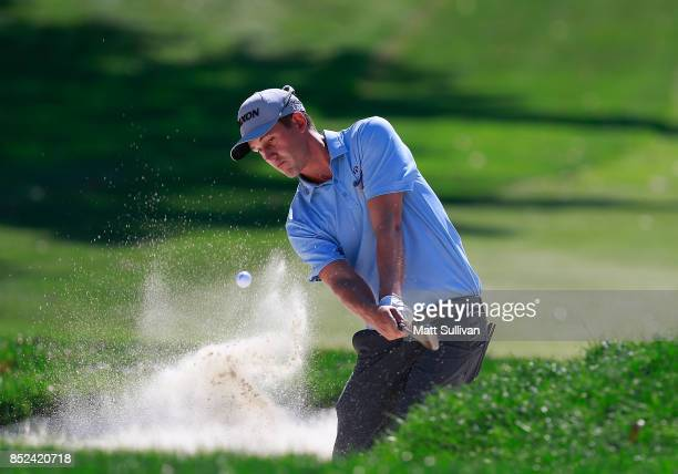 Andrew Putnam hits from a bunker on the first hole during the third round of the Webcom Tour DAP Championship on September 23 2017 in Beachwood Ohio