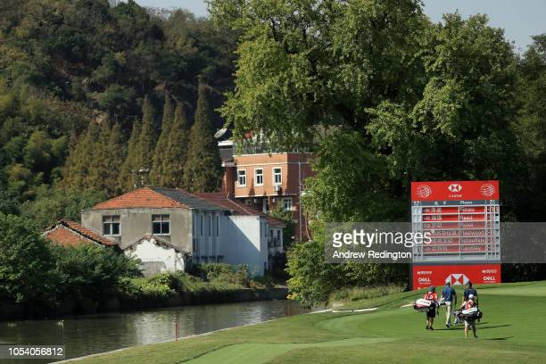 Andrew Putnam of the United States and Rafael CabreraBello of Spain walk on the fourth hole during the third round of the WGC HSBC Champions at...