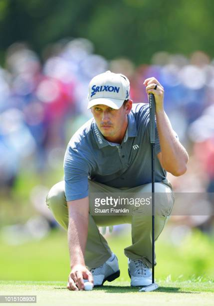 Andrew Putnam of the United States lines up a putt on the second green during the third round of the 2018 PGA Championship at Bellerive Country Club...