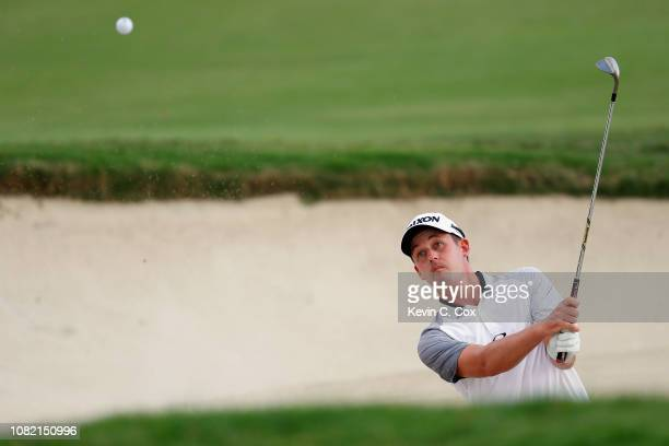 Andrew Putnam of the United States plays a shot from a bunker on the 14th hole during the final round of the Sony Open In Hawaii at Waialae Country...