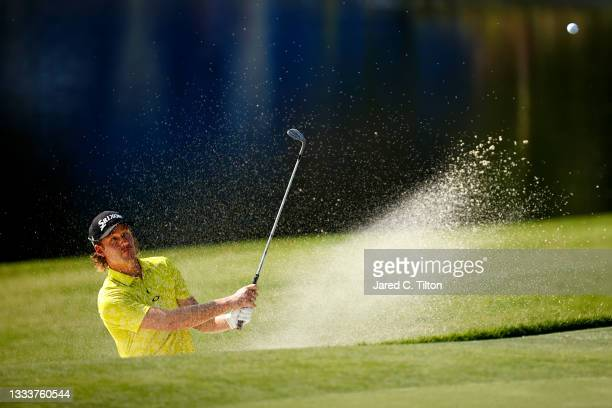 Andrew Putnam of the United States plays a shot from a greenside bunker on the 15th hole during the first round of the Wyndham Championship at...