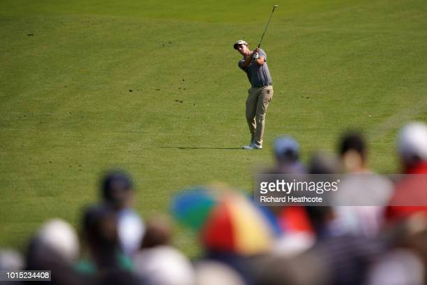 Andrew Putnam of the United States plays an approach shot on the 11th hole during the third round of the 2018 PGA Championship at Bellerive Country...