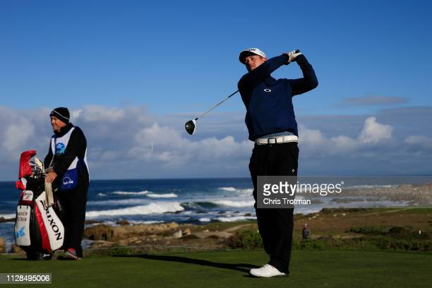 Andrew Putnam of the United States plays his shot from the 13th tee during the second round of the ATT Pebble Beach ProAm at Monterey Peninsula...