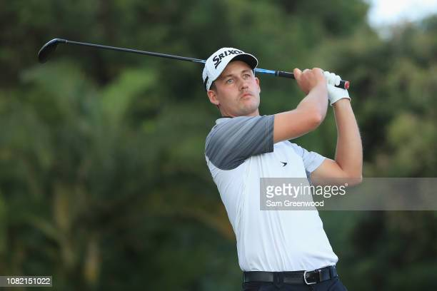 Andrew Putnam of the United States plays his shot from the 16th tee during the final round of the Sony Open In Hawaii at Waialae Country Club on...