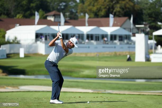 Andrew Putnam of the United States plays his shot from the 17th tee during the first round of the BMW Championship at Aronimink Golf Club on...