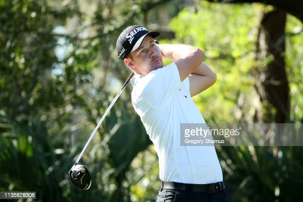 Andrew Putnam of the United States plays his shot from the fifth tee during the first round of The PLAYERS Championship on The Stadium Course at TPC...