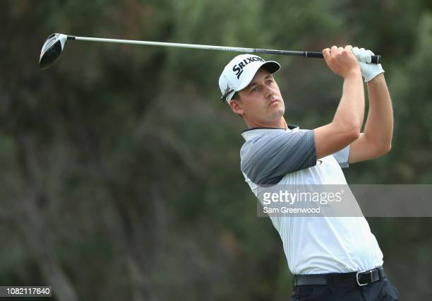 Andrew Putnam of the United States plays his shot from the first tee during the final round of the Sony Open In Hawaii at Waialae Country Club on...