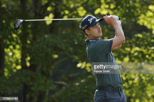 Andrew Putnam of the United States plays his shot from the fourth tee during round two of the Dell Technologies Championship at TPC Boston on...