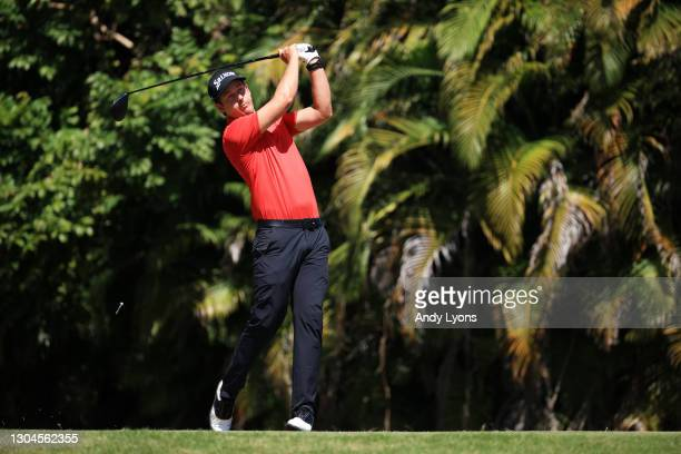 Andrew Putnam of the United States plays his shot from the fourth tee during the final round of the Puerto Rico Open at the Grand Reserve Country...
