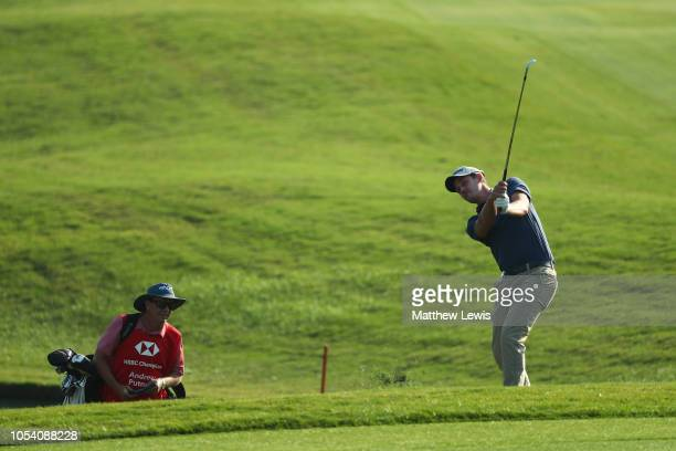Andrew Putnam of the United States plays his third shot on the 18th hole during the third round of the WGC HSBC Champions at Sheshan International...