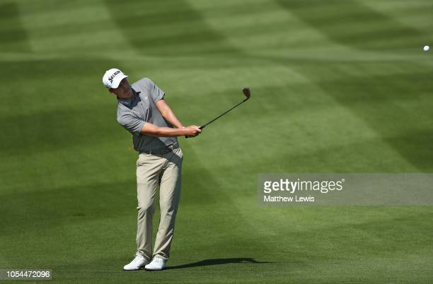 Andrew Putnam of the United States plays his third shot on the second hole during the final round of the WGC HSBC Champions at Sheshan International...