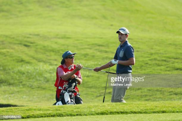 Andrew Putnam of the United States reacts to his third shot on the 18th hole during the third round of the WGC HSBC Champions at Sheshan...
