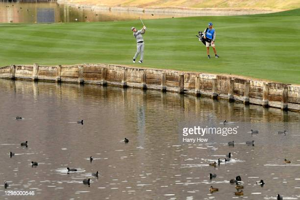 Andrew Putnam plays his shot on the fifth hole during the third round of The American Express tournament on the Stadium course at PGA West on January...