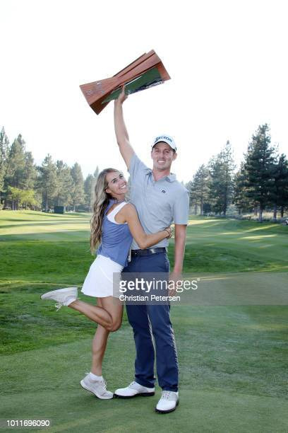 Andrew Putnam poses with his wife Tawny Frans Putnam and the trophy on the 18th hole during the final round of the Barracuda Championship at Montreux...
