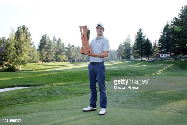 Andrew Putnam poses with the trophy on the 18th hole during the final round of the Barracuda Championship at Montreux Country Club on August 5 2018...