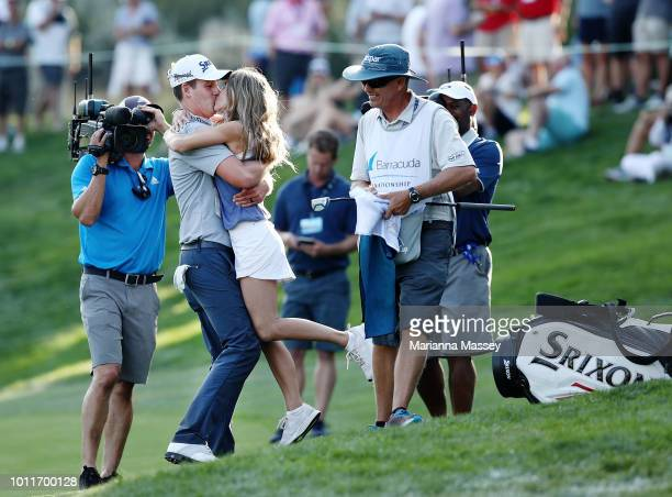 Andrew Putnam reacts after putting in for birdie on the 18th hole with his wife Tawny Frans Putnam during the final round of the Barracuda...