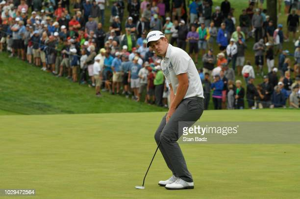 Andrew Putnam reacts to his putt on the seventh hole during the third round of the BMW Championship at Aronimink Golf Club on September 8 2018 in...