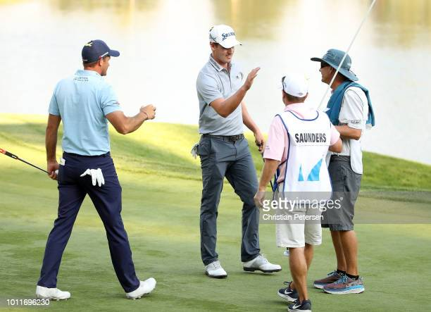 Andrew Putnam shakes hands with Sam Saunders on the 18th hole during the final round of the Barracuda Championship at Montreux Country Club on August...