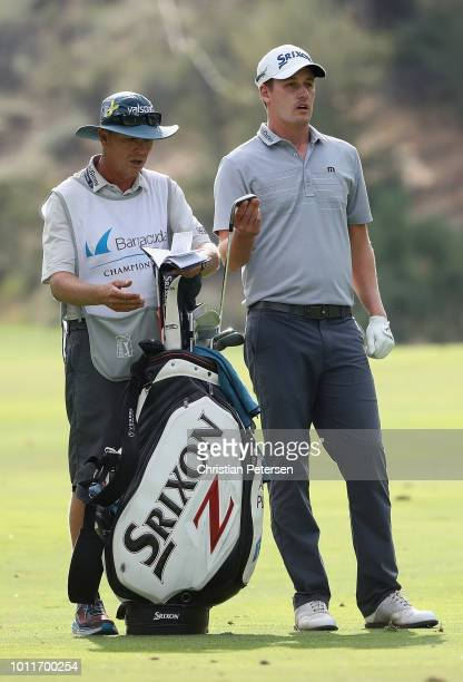 Andrew Putnam takes a club from his bag on the 17th hole during the final round of the Barracuda Championship at Montreux Country Club on August 5...