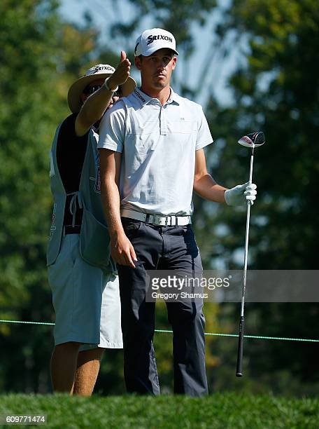 Andrew Putnam talks with his caddie about his drive on the sixth tee during the first round of the Webcom Tour Nationwide Children's Hospital...