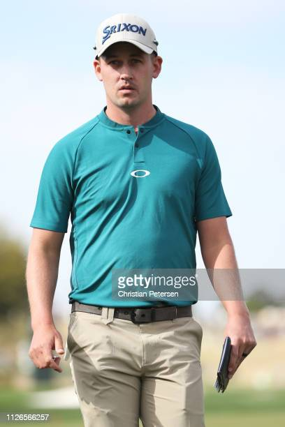 Andrew Putnam walks off the 15th green during the first round of the Waste Management Phoenix Open at TPC Scottsdale on January 31 2019 in Scottsdale...
