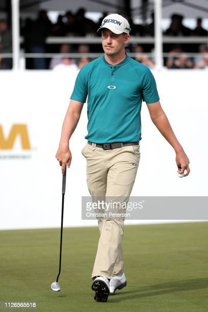 Andrew Putnam walks the 16th green during the first round of the Waste Management Phoenix Open at TPC Scottsdale on January 31 2019 in Scottsdale...