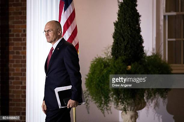 Andrew Puzder chief executive of CKE Restaurants exits after his meeting with presidentelect Donald Trump at Trump International Golf Club November...