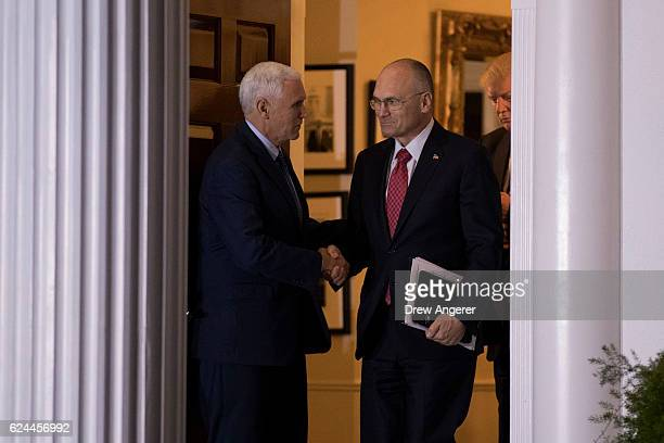 Andrew Puzder chief executive of CKE Restaurants shakes hands with vice presidentelect Mike Pence after their meeting with presidentelect Trump at...