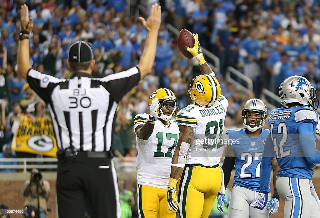 Andrew Quarless #81 of the Green Bay Packers celebrates after scoring a first quarter touchdown with teammate Davante Adams #17 during the game against the Detroit Lions at Ford Field on September 21, 2014 in Detroit, Michigan.