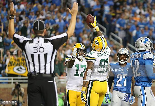 Andrew Quarless of the Green Bay Packers celebrates after scoring a first quarter touchdown with teammate Davante Adams during the game against the...