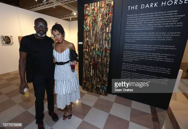 Andrew Quarrie poses with Carol Cooper at the VIP preview of the 2018 PRIZM Art Fair in the Dupont Building on December 3 2018 in Miami Florida