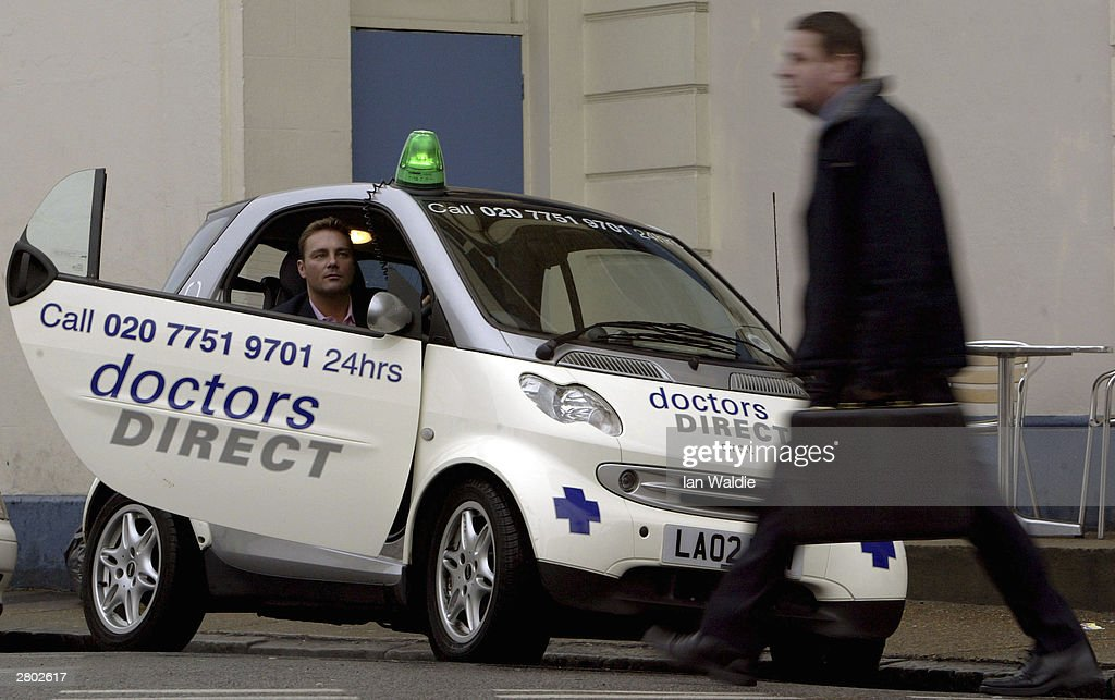 Andrew Rae McCance, Chief Executive of Doctors Direct, sits in one of the on-call doctors cars December 11, 2003 in London. Home visits by doctors are becoming a popular alternative to the accident and emergency service offered on the NHS system.