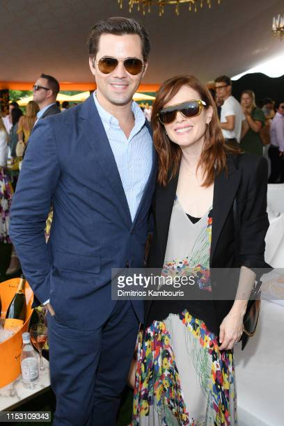 Andrew Rannells and Julianne Moore attend the 12th Annual Veuve Clicquot Polo Classic at Liberty State Park on June 01 2019 in Jersey City New Jersey