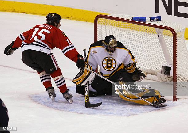 Andrew Raycroft of the Boston Bruins and YoungStars East makes a save against Tuomo Ruutu of the Chicago Blackhawks and the YoungStars West in the...