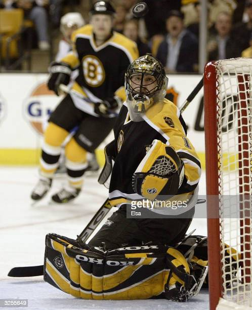 Andrew Raycroft of the Boston Bruins stops a shot by the Montreal Canadiens in the second period April 7, 2004 at the Fleet Center in Boston,...