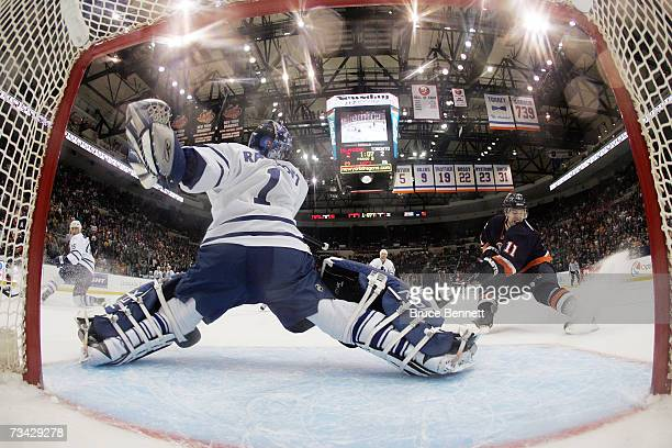 Andrew Raycroft of the Toronto Maple Leafs defends the net against Andy Hilbert of the New York Islanders on February 22 2007 at Nassau Coliseum in...