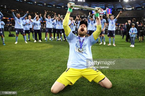 Andrew Redmayne of Sydney FC celebrates with the trophy after winning the 2019 ALeague Grand Final match between the Perth Glory and Sydney FC at...
