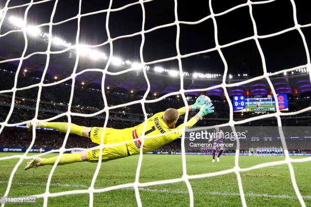 Andrew Redmayne of Sydney FC saves a goal attempt by Andy Keogh of the Glory during the penalty shootout following extratime during the 2019 ALeague...