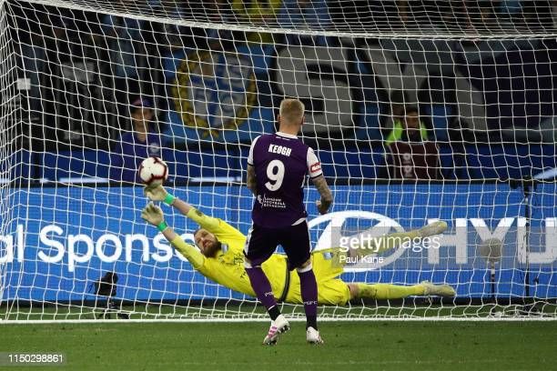 Andrew Redmayne of Sydney saves a shot on goal by Andy Keogh of the Glory in the penalty shootout during the 2019 ALeague Grand Final match between...