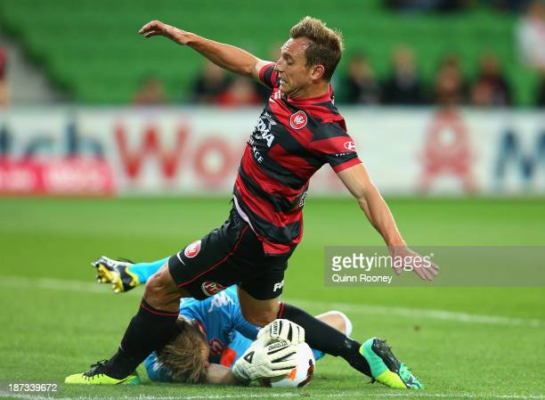 Andrew Redmayne the goal keeper for Heart stops a shot on goal by Brendon Santalab of the Wanderers during the round five ALeague match between...