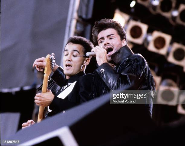 Andrew Ridgeley and George Michael of Wham perform on stage at 'The Final Concert' Wembley Stadium London 28th June 1986