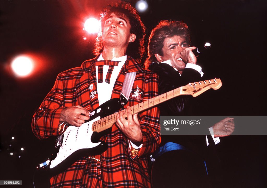 Andrew Ridgeley and George Michael of Wham! perform on stage in London, 1984.